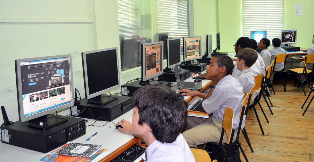 Fatima college students utilizing the new donated computers in the school's computer lab