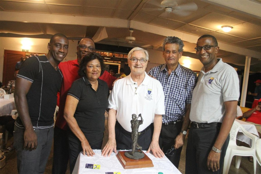 Winning pair Trent Noel and Ulric McNicol, left, along with Janet Ali (winner), Clive Pantin, Rasheed Ali (winner) and current Fatima College principal, Father Gregory Augustine, pose with the namesake Clive Pantin Trophy, at the award function following the conclusion of the Fatima Class of 1975 Charity Golf Classic held recently at Moka Golf Club, Maraval.