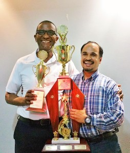 Roger and Father Gregory with the Math Olympiad trophies